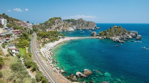 Sicily Island Coast at Taormina Italy at Isola Bella Beach with Hillside and Railroad Bordering the Blue Mediterranean Sea Water on a Sunny Day in Europe