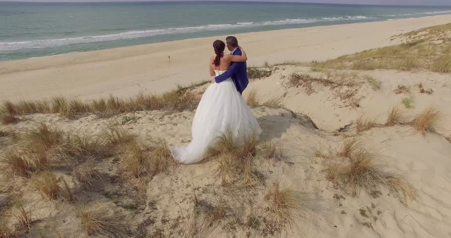 Beautiful couple on the beach in love | Shutterstock HD Video #20446012