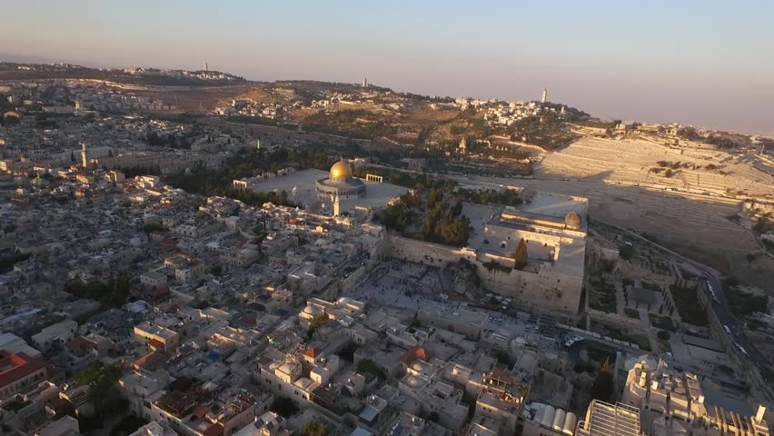 Aerial view of Jerusalem old city, Temple mount mosque, Western wall  Israel- Palestine Epic evening shot around Jerusalem old city with Dome of the Rock on Temple mount and facing the western wall | Shutterstock HD Video #20482498