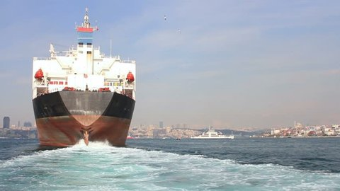 Large ship sailing through Straits in Istanbul, Turkey. Back view of the oil tanker ship