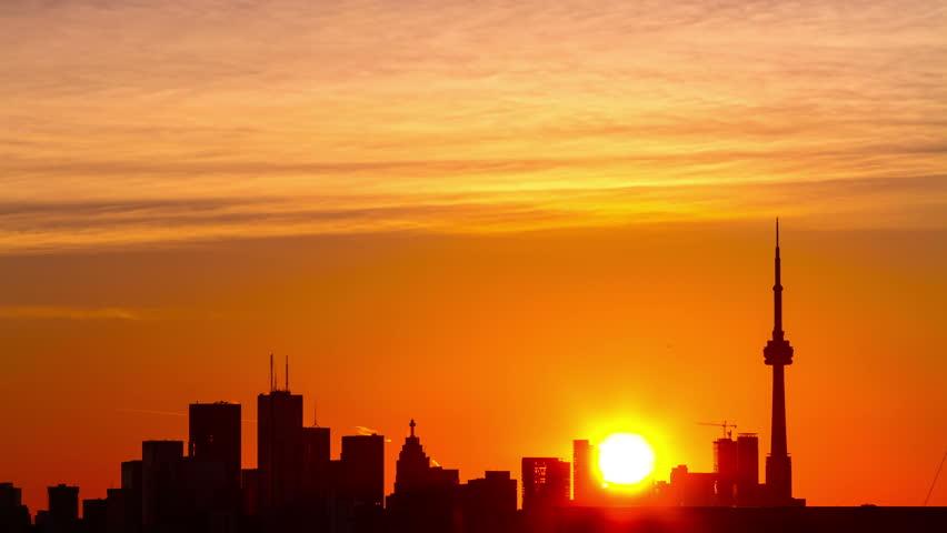 Sun rising behind Toronto skyline  4k Timelapse   Shutterstock HD Video #20485666