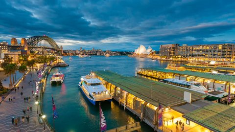 Sydney, Australia - June 26, 2016: 4k timelapse video of ferries and people visiting Circular Quay in Sydney CBD, with view of Harbour Bridge and Opera House