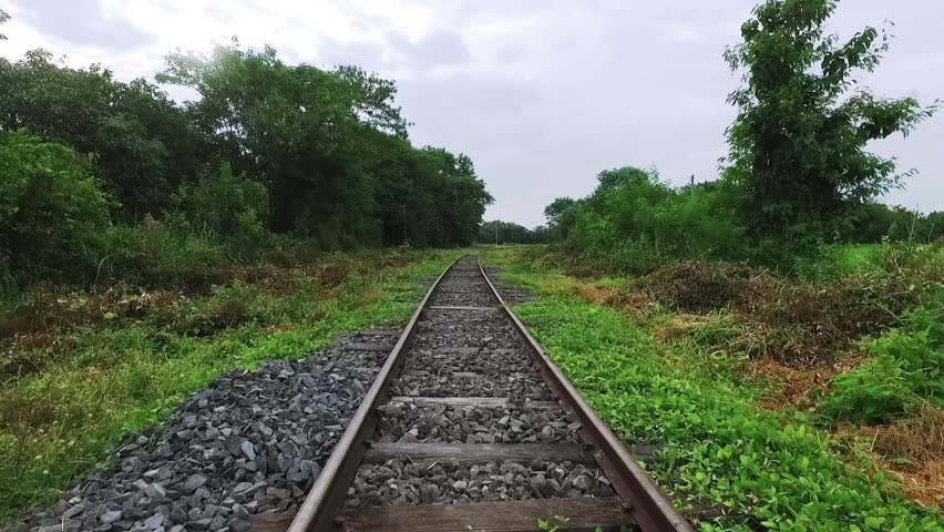 Walk along abandoned railway beside the forest in first person view | Shutterstock HD Video #20583022