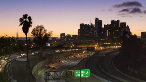 Los Angeles, California, United-States - October 16th 2016 - Downtown Los Angeles and Freeway Day To Night Sunset Timelapse