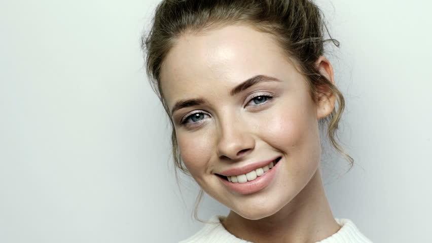Business woman portrait. Happy smiling young female professional indoor portrait closeup | Shutterstock HD Video #20647582