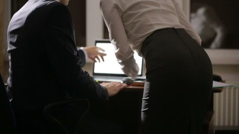 harassment in the workplace. man touching woman's ass