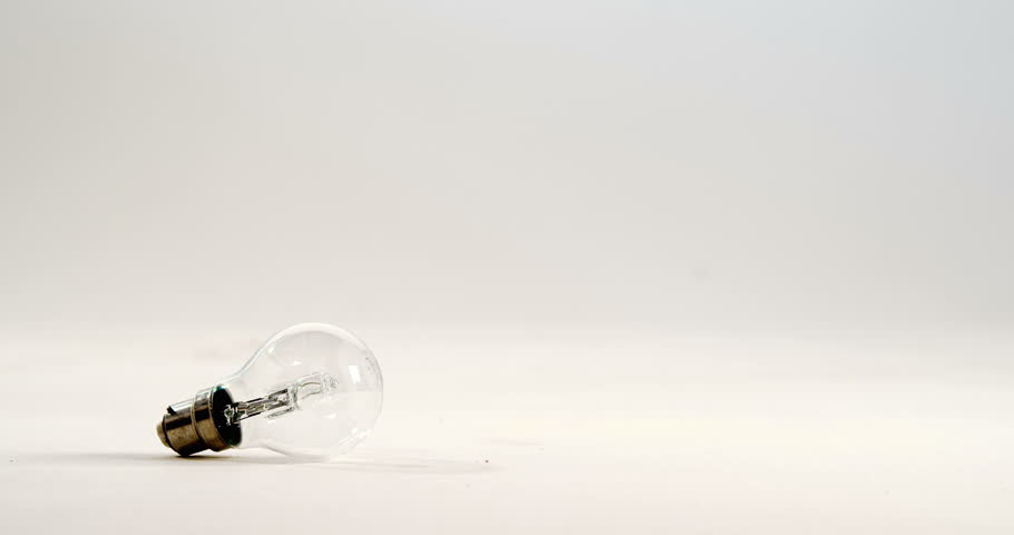 Electric bulb falling against white background 4k | Shutterstock HD Video #20674012