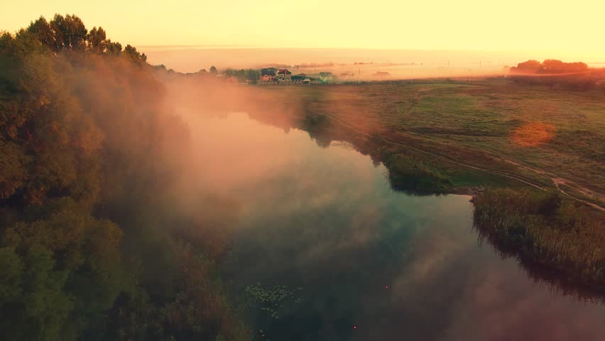 Aerial View. Fisherman at sunrise on the river in the boat Aerial camera shot. | Shutterstock HD Video #20677942