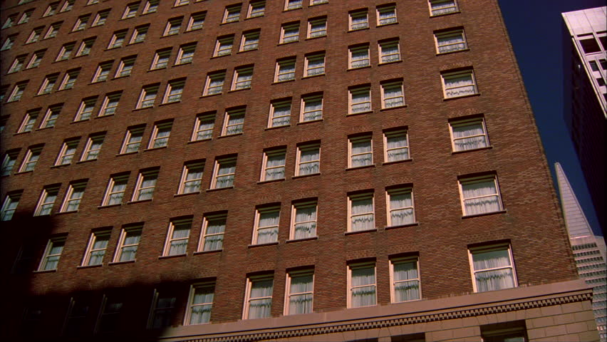 Day Up Angle Windows Large Old Brick Apartment Building Other Tall Buildings Including Trans America