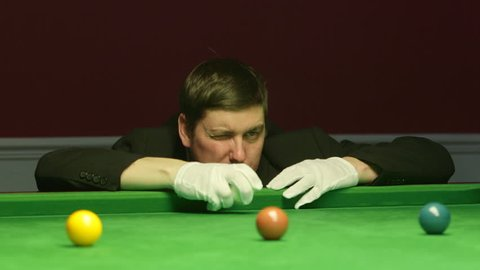 Snooker Referee Replacing The White Cue Ball