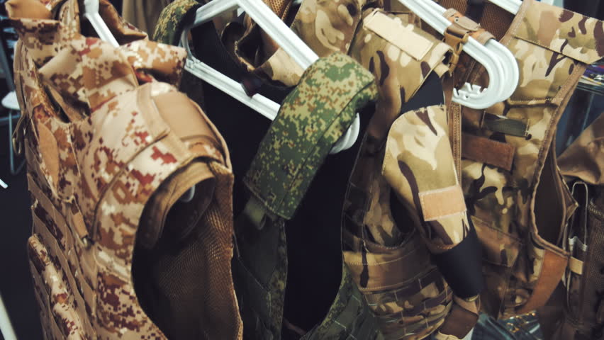 In the Army store on hangers new bulletproof vests sand-colored and khaki color