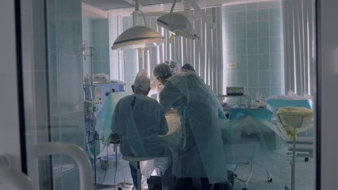 Hospital medical team performing surgery in operating room