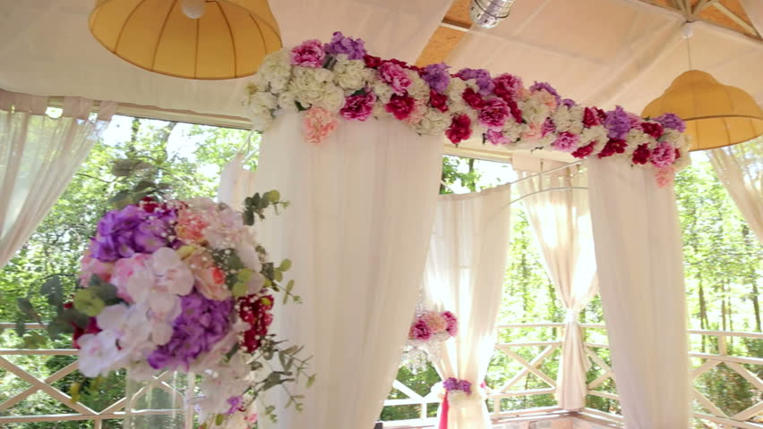 wedding arch of four columns with floral compositions on columns hd stock video clip