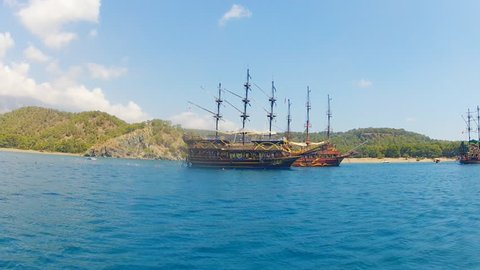 Beautiful pirate schooner in the sea. Overall view.