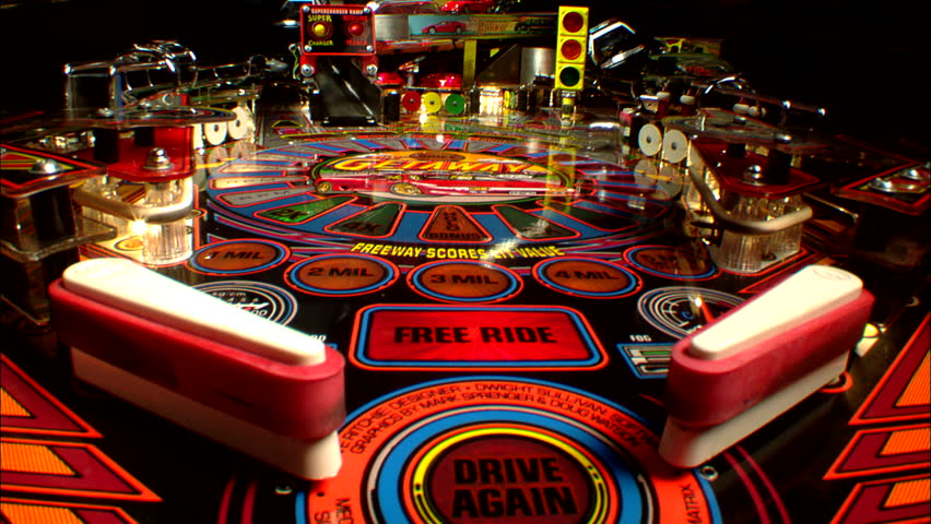INTERIO right INSERT Static Tight CU Low POV across playfield car auto themed pinball machine, from behind flippers Game progress, multiple balls play arcade, games `