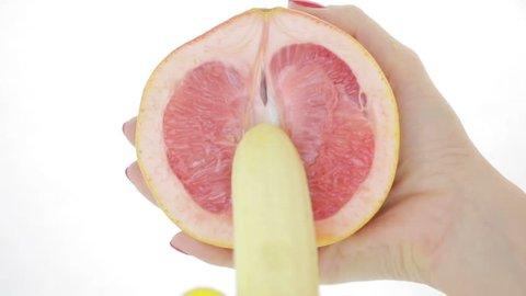 concept of sex. grapefruit and banana. close-up