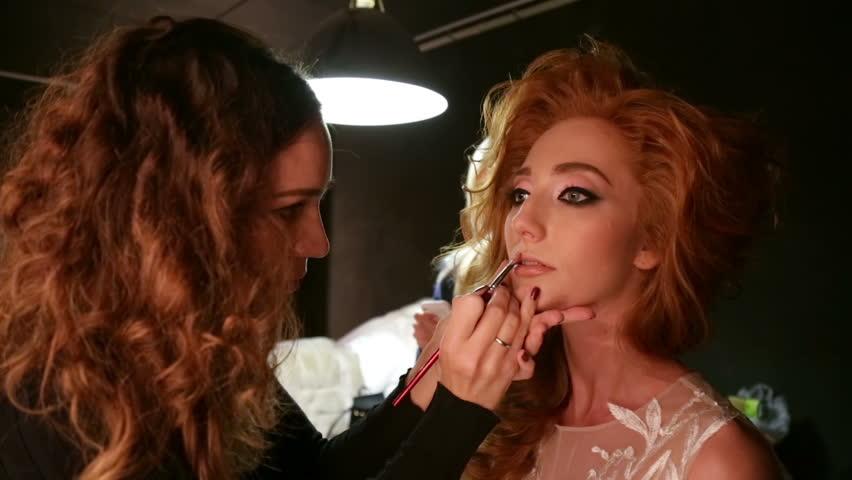 Makeup artist apply makeup girl. | Shutterstock HD Video #20751448
