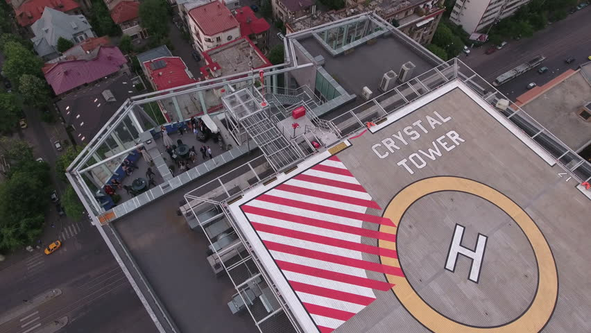 Aerial shot of a helipad with helicopter landing… - Royalty Free Video