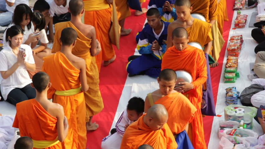 BANGKOK - MARCH 18: Monks are participating in a Mass Alms Giving of 12,600 monks in Central World for the Makha Bucha celebrations on March 18, 2012 in Bangkok, Thailand.