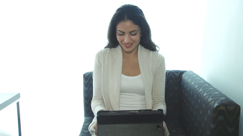 Pretty businesswoman working with tablet computer