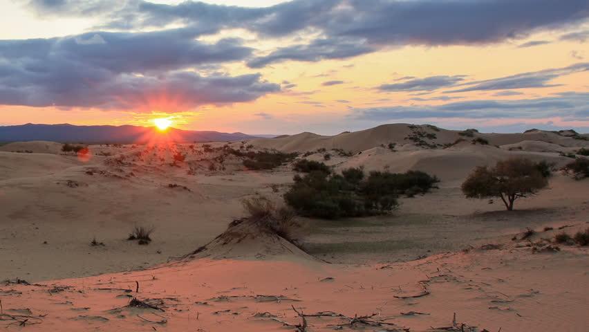 Sunset over the Gobi desert, dune Hongoryn, Mongolia. Full HD