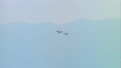 day Ground air MiG 23 F 21 Kfir fighter jet chasing F 4E Phantom II Phantom passes over MiG Kfir warfare, dogfight playback