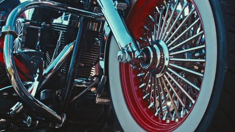 Close up of a red and white custom bike wheel / Europe's biggest Harley Davidson event 6-11 September 2016 (Faaker See/AUT) 4K editorial footage
