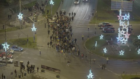 BUCHAREST, ROMANIA - DECEMBER 01, 2015: People gathering for Protest In University Square And In Front Of National Theater Against Corruption And Romanian Government, on the Romania`s National Day.