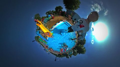 Opole/poland - Aug 12 2016: Tiny Little Planet 360 Degree Timelapse. Kids in Opole Aqua Park in Youth Day, Swim in Pool Rubber Ring, Having Fun. Children Getting Down by Chutes, Playing Together in a