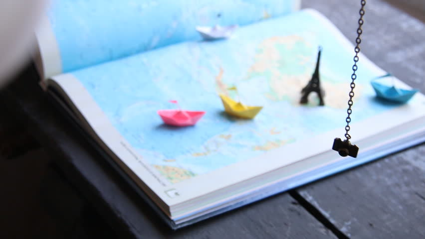 Vacation planner idea. Tourism. Paper boats on the map and the Eiffel Tower. | Shutterstock HD Video #20877862