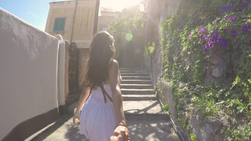 Beautiful girlfriend leading boyfriend up scenic Amalfi street pov romantic looking and smiling together on travel adventure Gopro | Shutterstock HD Video #20878042