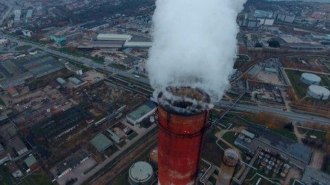 Coal fire power statio. Smokig pipe, close up. Aerial.