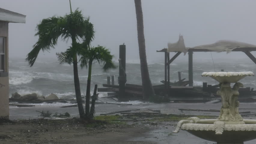 Cocoa Beach, FL/US - October 8, 2016 [4K Hurricane Matthew producing hurricane force wind gusts a pounding local beach motel along with damaging storm surge.]