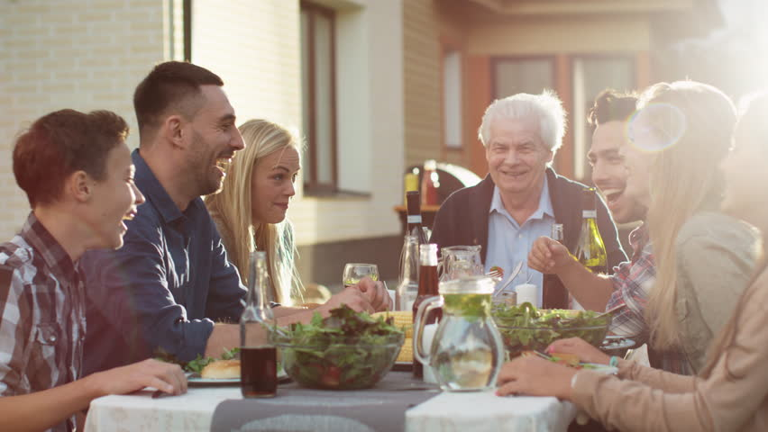 Group of Mixed Race People Having fun, Communicating and Eating at Outdoor Family Dinner. Shot on RED Cinema Camera in 4K (UHD). | Shutterstock HD Video #20914252