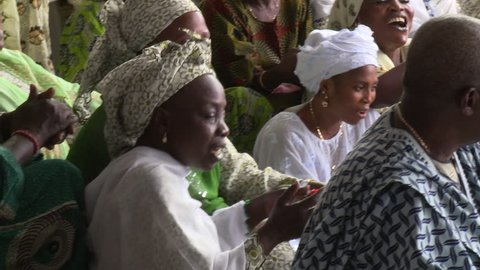 Osogbo, Nigeria - August 2013;Women singing at ceremony at Ataoja palace.
