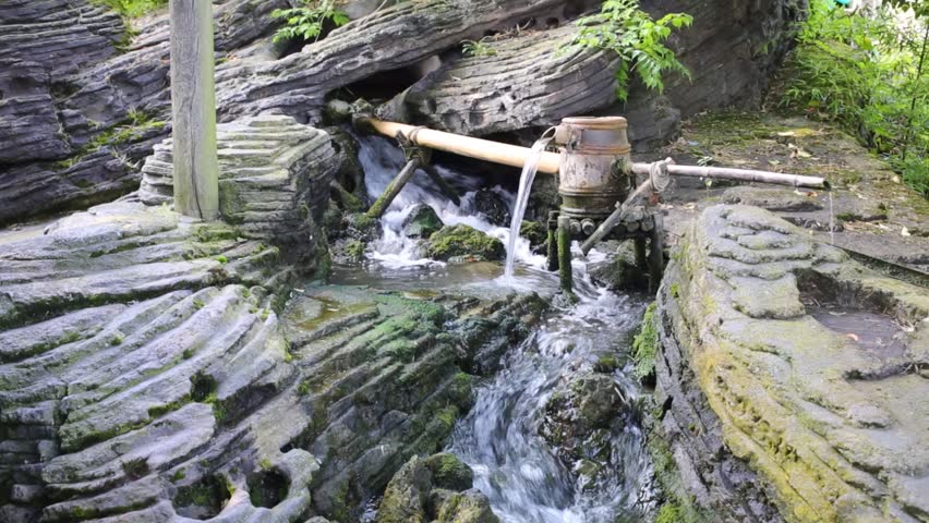 Stream Among Grey Rocks With Drum And Trough At Summer   HD Stock Footage  Clip