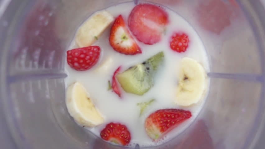 fruit mixing into blender seen from inside slow motion
