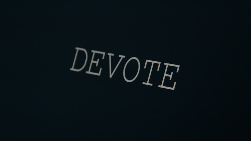 Typing word on a black background, devote   Shutterstock HD Video #20985712