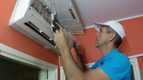 Smiling Air Conditioning Master Showing Thumbs Up / Air conditioner repair man at work showing ok sign. HD1080p