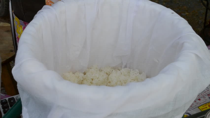 Scooping sticky rice into bag