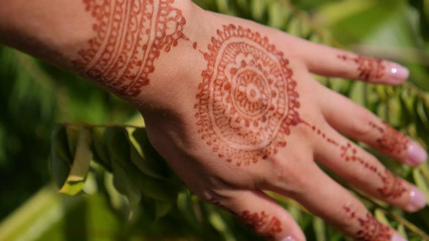 Mehndi Henna Hd : Woman hand with mehndi henna tattoo closeup stock footage video