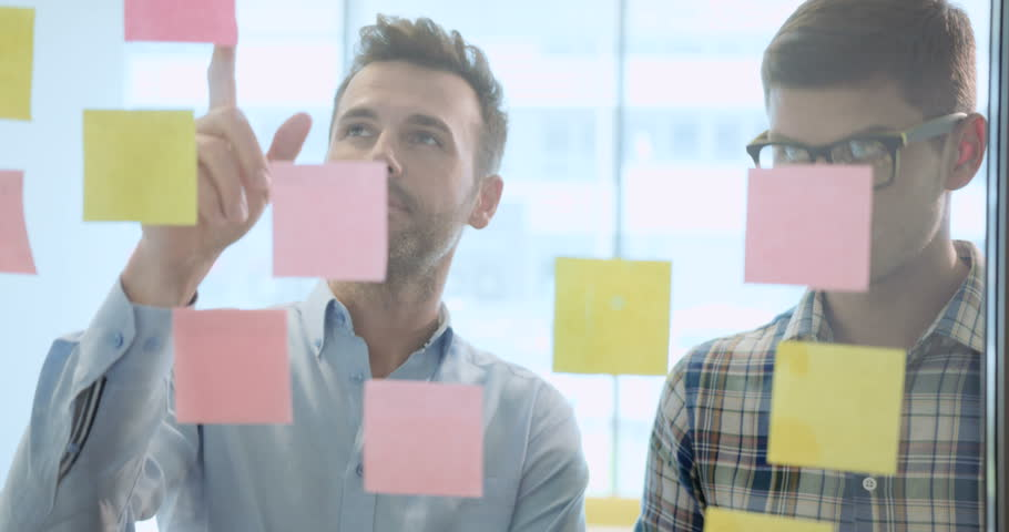 Creative business people brainstorming ideas at the office | Shutterstock HD Video #21045445