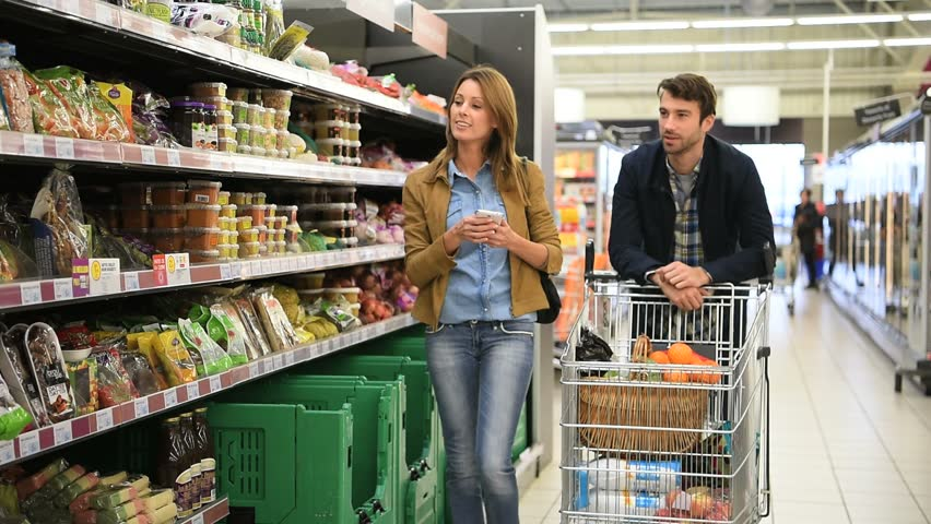 Couple Pushing Shopping Cart In Stock Footage Video 100 Royalty Free 21052372 Shutterstock