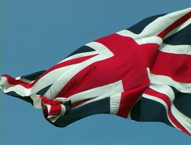 A United Kingdom flag blowing in the wind.