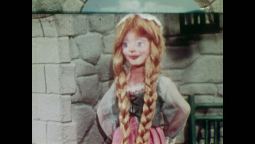 ANIMATED 1950s: Witch gets angry with Rapunzel and picks up scissors. Witch cuts off Rapunzel's hair.