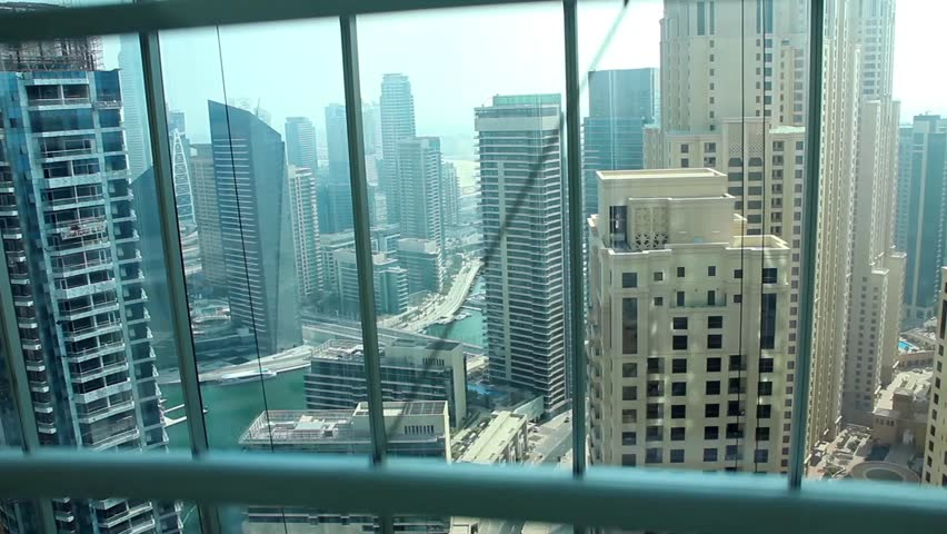 view of buildings from glass elevator