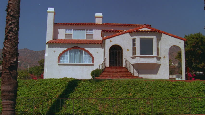 Day Push Bay Window 1st Floor Large Corner Two Story Spanish Mediterranean House Tiled Roof Sits Up Bit Palms