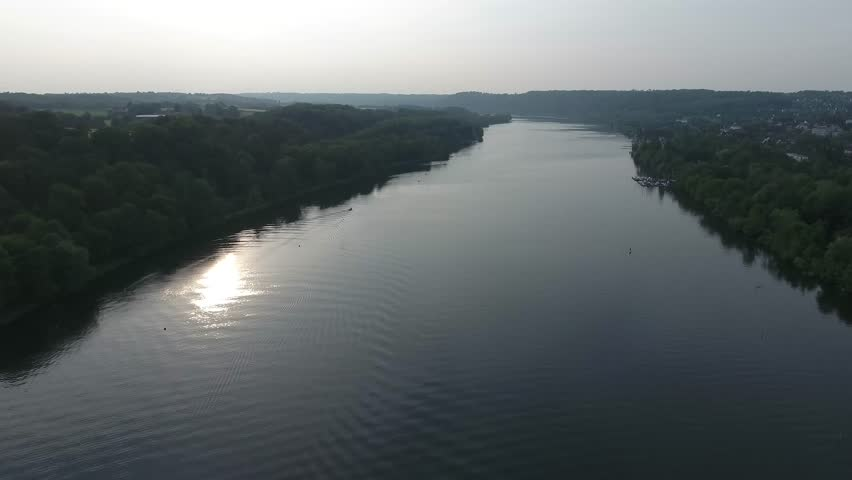 Sun on Water Aerial View Essen Ruhr River in Summer Sunset flying past small Islands in the River