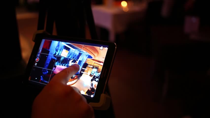 MOSCOW - APR, 16, 2016: Finger touching tablet computer, which control camera, shooting man on scene jazz club Kino. In Jazz club Kino musician Viktor Zinchuk present new album Triumph of Guitar.  | Shutterstock HD Video #21138010