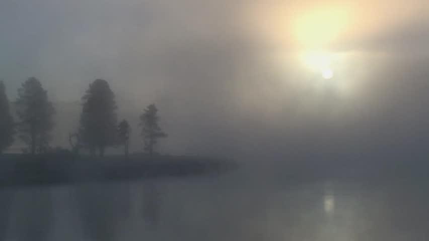 Sunrise over a misty lake  #2115362